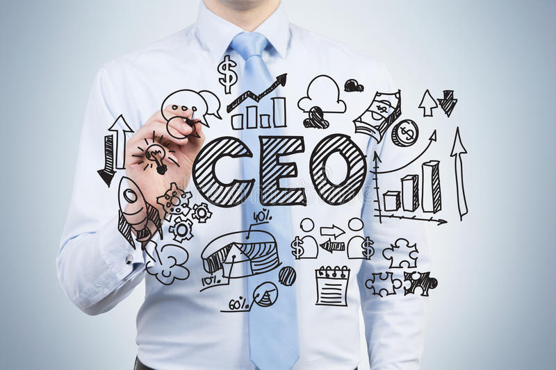 An ambitious employee is drawing a corporate governance chart on the glass screen. A CEO is in a core part of the chart. stock image