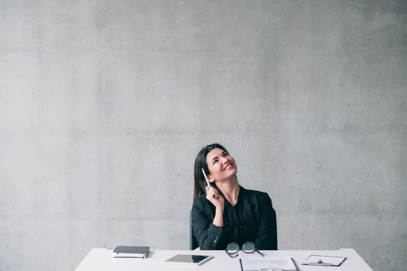 Ambitious inspired business woman thinking project royalty free stock image