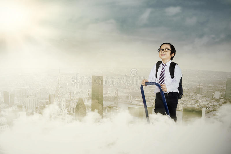 An ambitious little businessman. Portrait of an ambitious little businessman on a ladder stepping up royalty free stock photography
