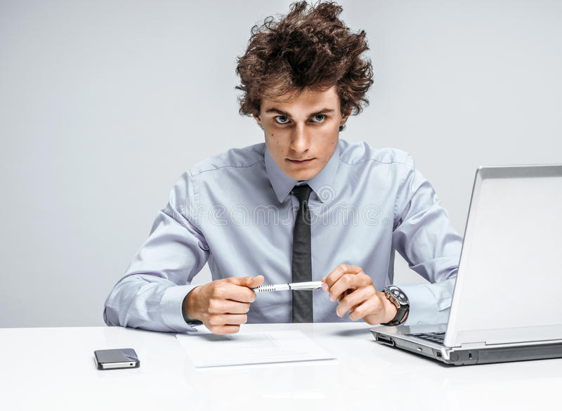 Ambitious young businessman looking at camera with serious look royalty free stock images