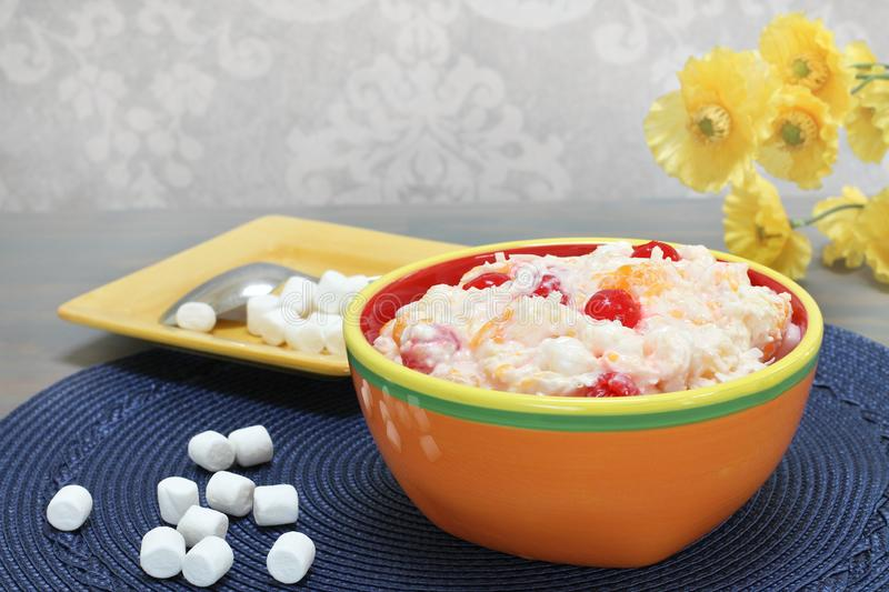 Ambrosia salad of oranges, cherries, coconut and marshmallows royalty free stock images