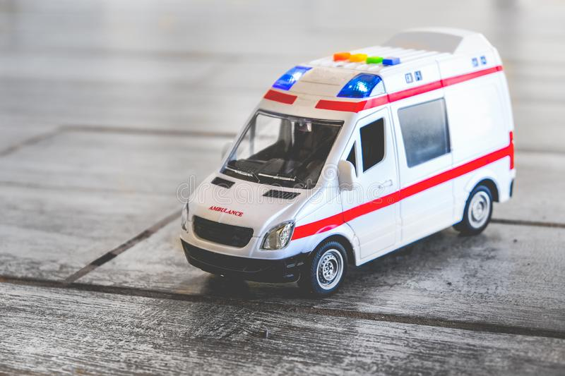 Ambulance background toy medical health care vehicle sirens blue lights.  royalty free stock photos