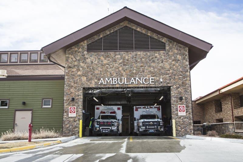 Ambulance bay public hospital emergency entrance. The two ambulances parked in the ambulance bay of a public hospital building are ready for er emergency stock photos