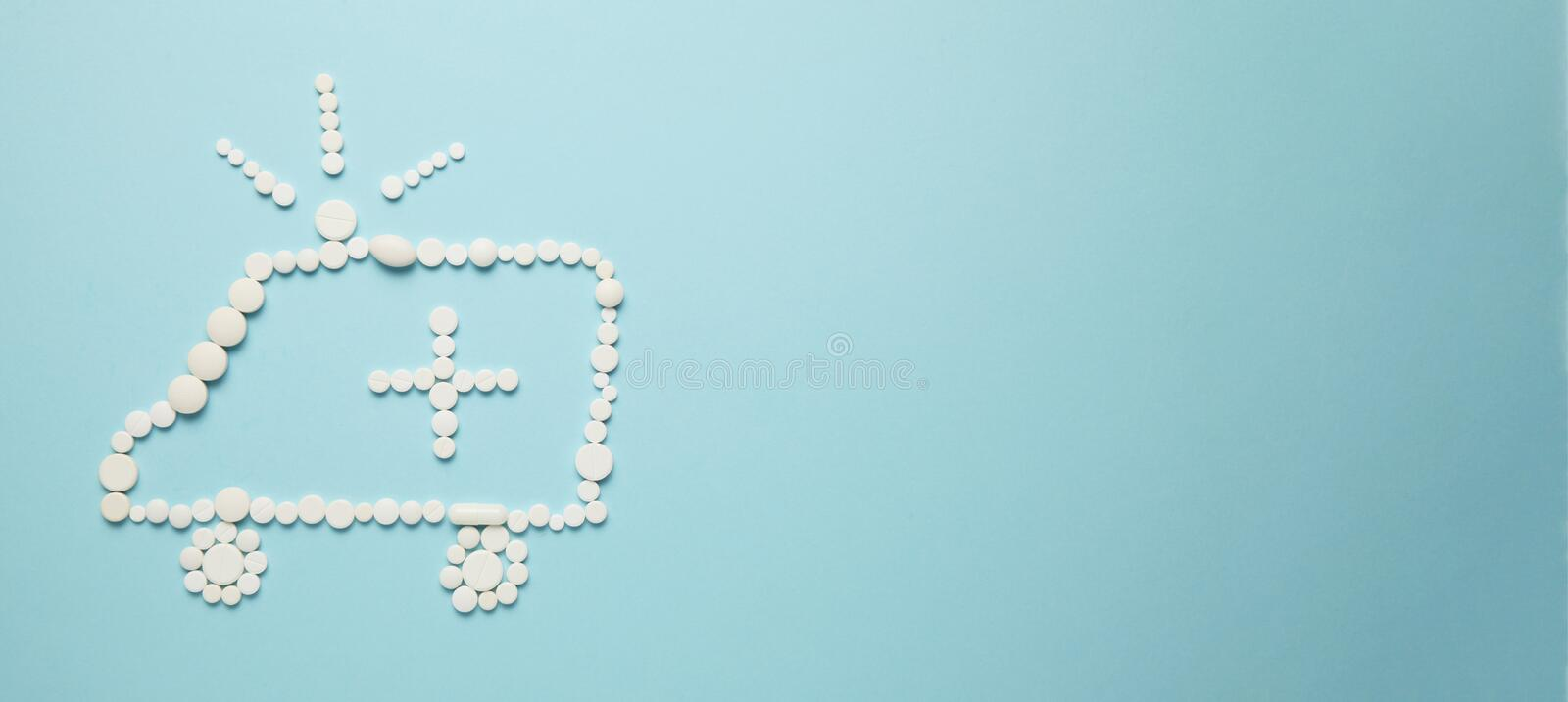 Ambulance car and siren of pills and cross. Children`s art concept. Copy space for text.  stock images