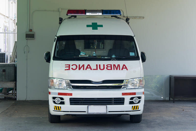 Ambulance. The ambulance car standby in garage stock photo