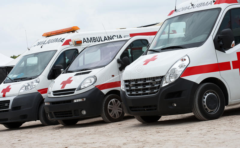 Ambulance cars. Ambulance cars parked on the beach stock image