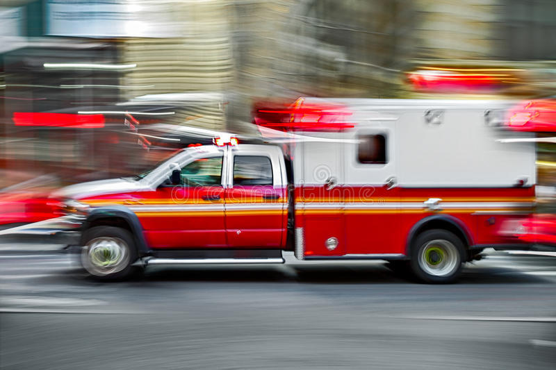 Ambulance on emergency call. In motion blur royalty free stock image