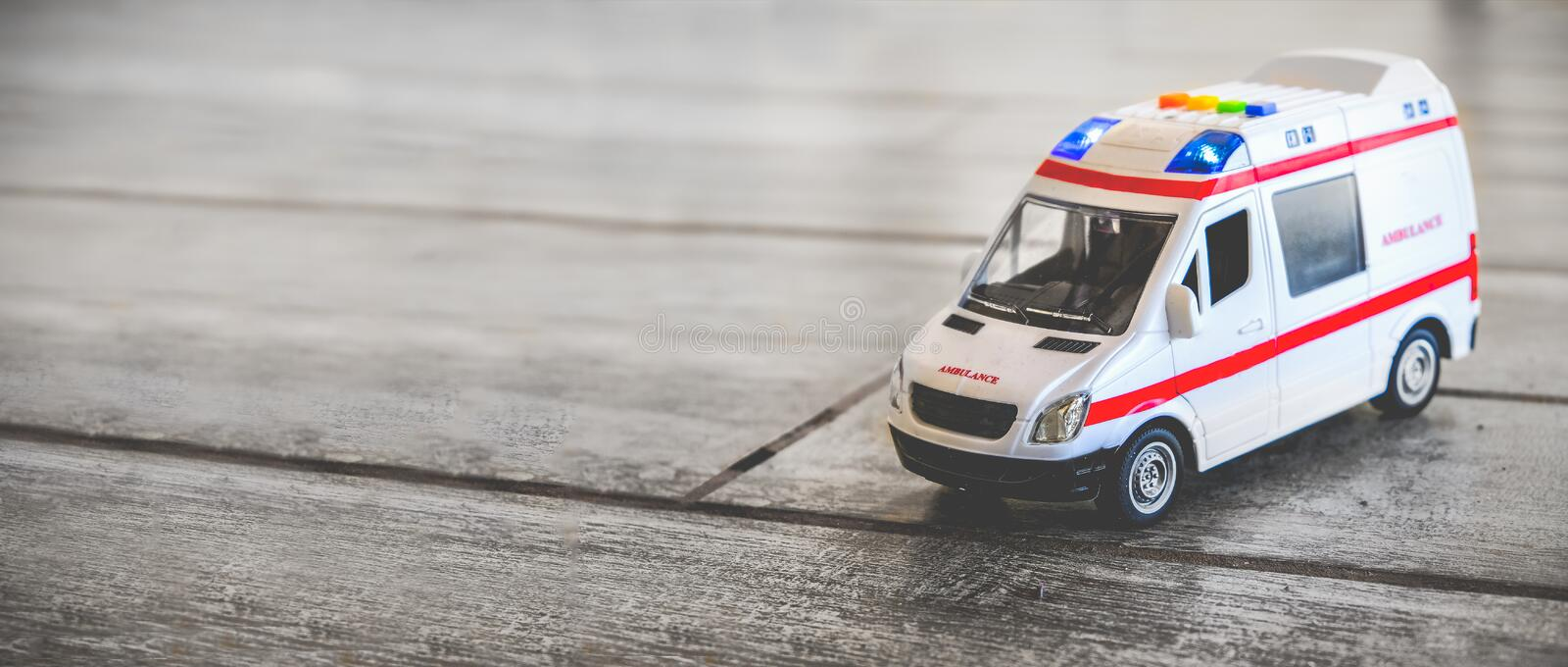 Ambulance horizontal background health care toy sirens blue lights copy space.  royalty free stock images