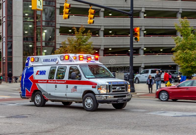 Ambulance in an intersection in Grand Rapids, Michigan. An AMR American Medical Response ambulance  drives through an intersection  in Grand Rapids, Michigan royalty free stock photos