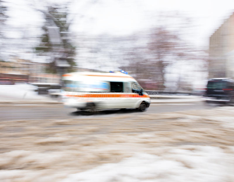 Ambulance in motion stock images