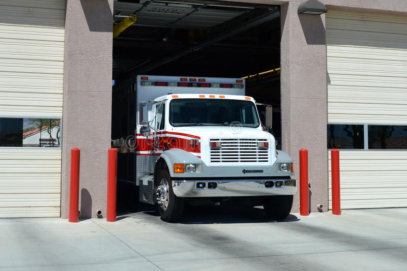 AMBULANCE. Pulling out of it's station royalty free stock images