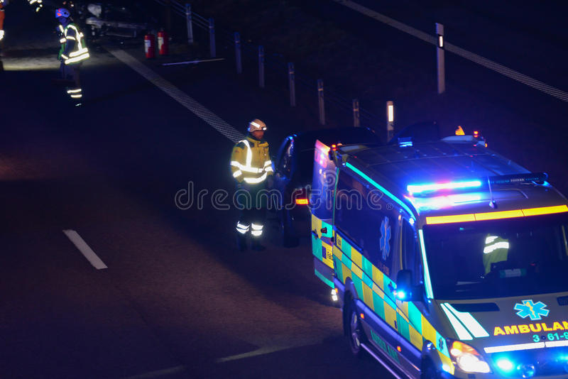 Ambulance on road. An ambulance on the road at night stock photos