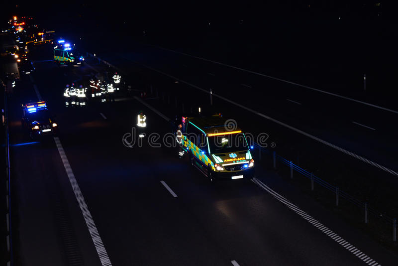 Ambulance on scene of accident. Ambulance and emergency crews at scene of traffic accident stock photo