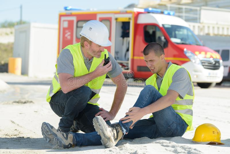 Ambulance signaled at work site due to accident. Ambulance stock photo