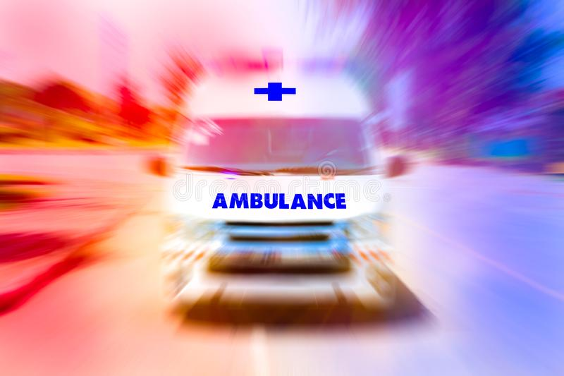 Ambulance speeding to accident first aid abstract motion blur shot. royalty free stock photography