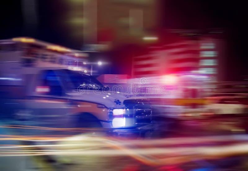 An ambulance speeding through traffic. At nighttime stock photo