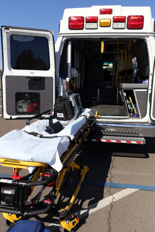 Ambulance and Stretcher. Sacramento, CA, USA - October 9, 2016: An ambulance and stretcher parked in a parking lot. An ambulance is a vehicle used for the royalty free stock images
