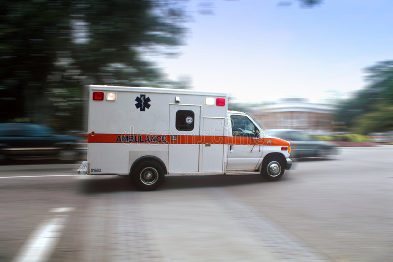 Ambulance sur le mouvement photo stock