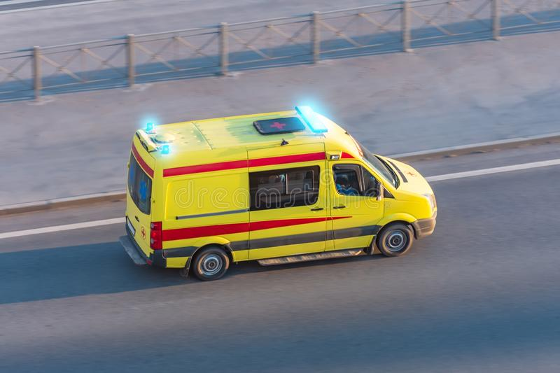 Ambulance van fast ride on highway, aerial top view royalty free stock photo