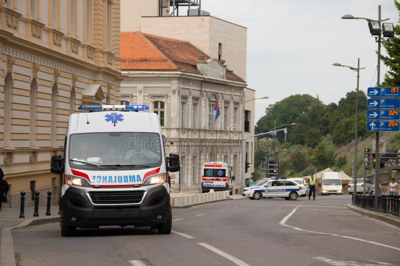 Ambulance vehicle on the street, with Police in background, securing public event. In Belgrade, Serbia royalty free stock image