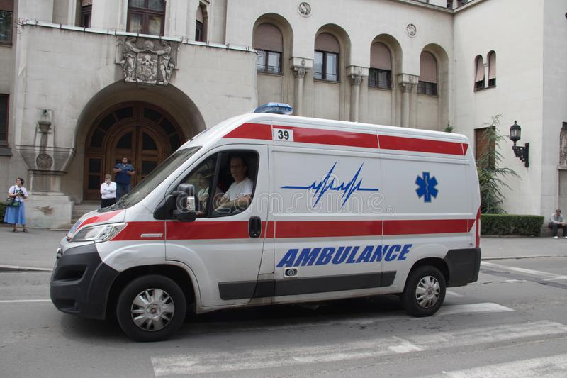 Ambulance vehicle on the street, with Police in background, securing public event. In Belgrade, Serbia royalty free stock photo