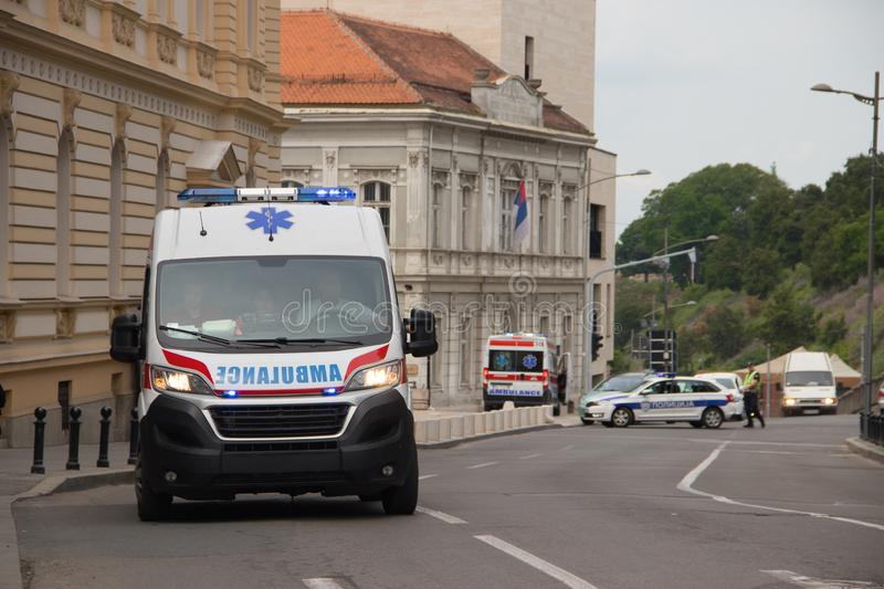 Ambulance vehicle on the street, with Police in background, securing public event. In Belgrade, Serbia stock images