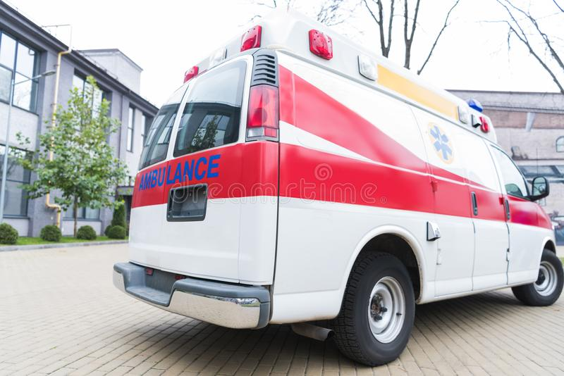 Ambulance white and red car. On street stock image
