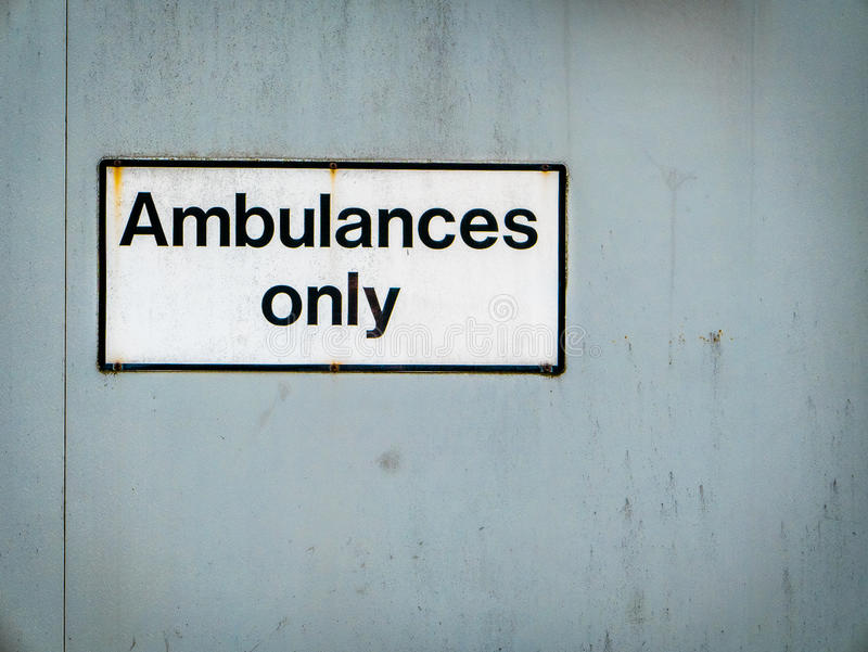 Ambulances Only Hospital Sign. A Grungy Ambulances Only Sign At A Hospital Emergency Room royalty free stock images