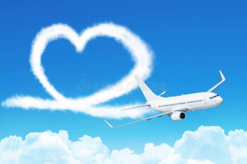 Ame el corazón en el aeroplano de la aviación del concepto del cielo foto de archivo