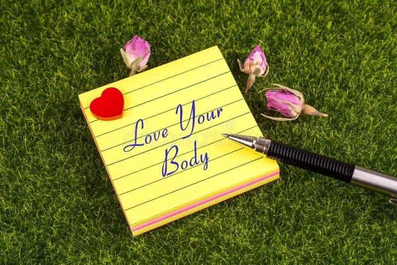 Ame sua nota do corpo foto de stock royalty free