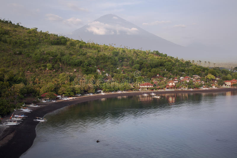Black Sand Beach and Volcano in Bali royalty free stock images