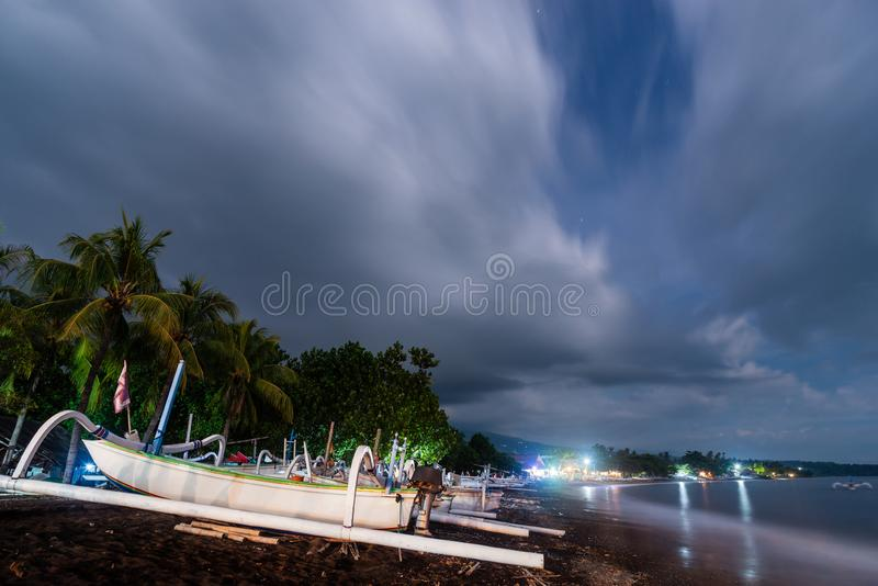 Amed beach at night in Bali, Indonesia royalty free stock photo