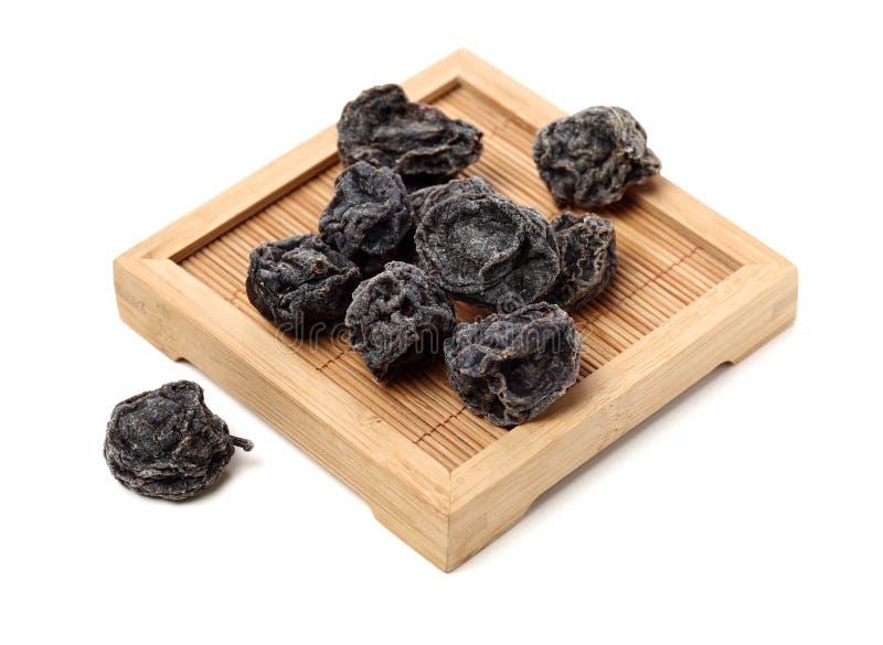 Ameixas pretas secadas fotografia de stock
