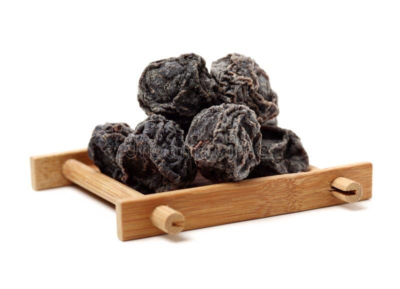 Ameixas pretas secadas imagem de stock