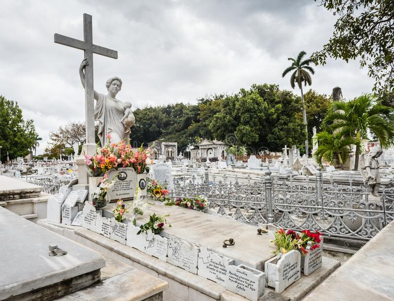 "Amelia Goyri Tomb - Colon, Cemetery. Havana, Cuba / March 21, 2016: Tomb of Amelia Goyri, ""La Milagrosa."" The legend goes that after she died in royalty free stock photo"