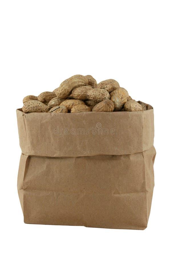 Amendoins em um saco imagem de stock