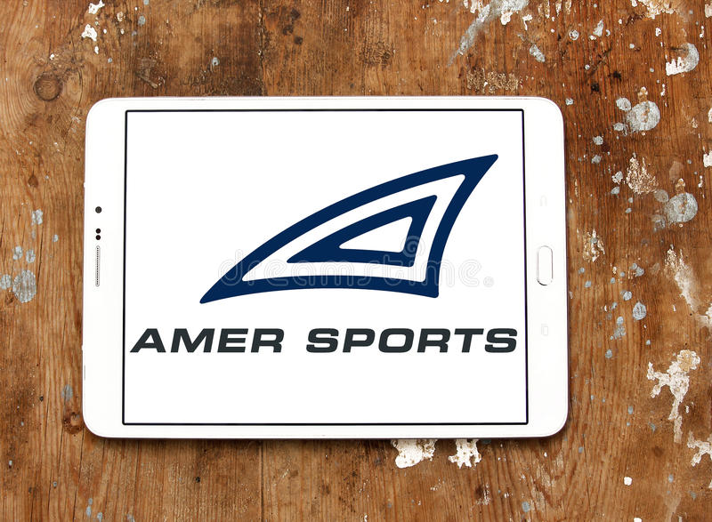 Amer Sports company logo. Logo of Amer Sports company on samsung tablet on wooden background. Amer Sports is a Finnish headquartered sporting goods company with royalty free stock photos