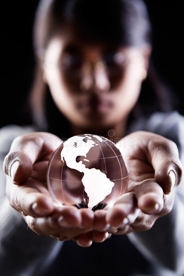 America continent. A woman holding a glass globe showing America continent royalty free stock photography