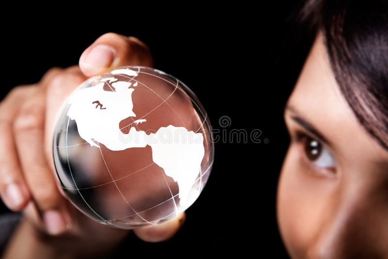 America continent. A woman examining a glass globe which showing America continent stock photo