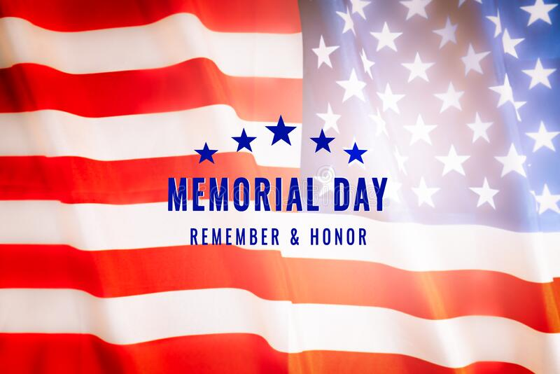 Memorial day USA national holiday text on america flag stock photo