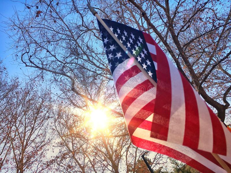 America flag and sun. American flag with rising sun royalty free stock photos