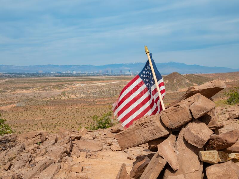 America flag swinging with Las Vegas strip as background. In the Las Vegas Wash trail at Hednerson, Nevada royalty free stock photo