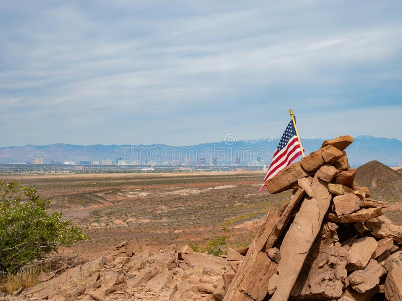 America flag swinging with Las Vegas strip as background. In the Las Vegas Wash trail at Hednerson, Nevada royalty free stock photos