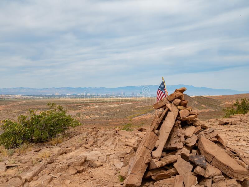 America flag swinging with Las Vegas strip as background. In the Las Vegas Wash trail at Hednerson, Nevada stock photo