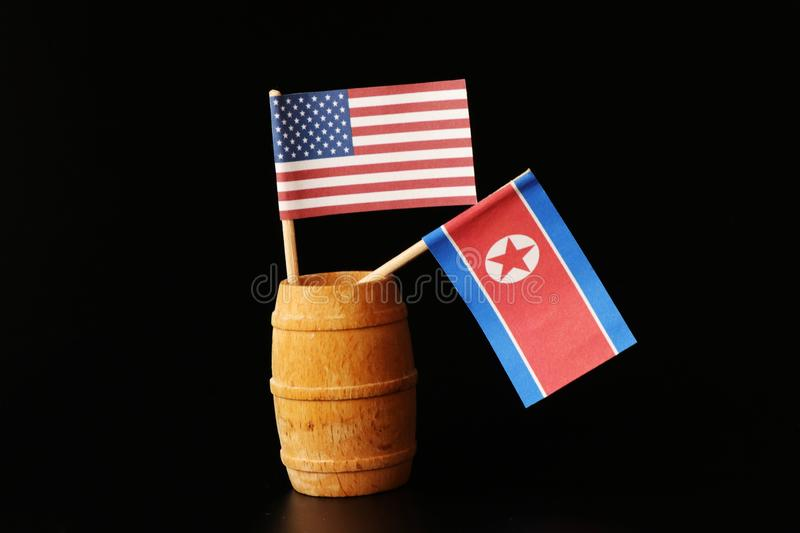 A america and north korea. Discussing about the decommissioning of nuclear power. Silence war between these two states. Black background stock image