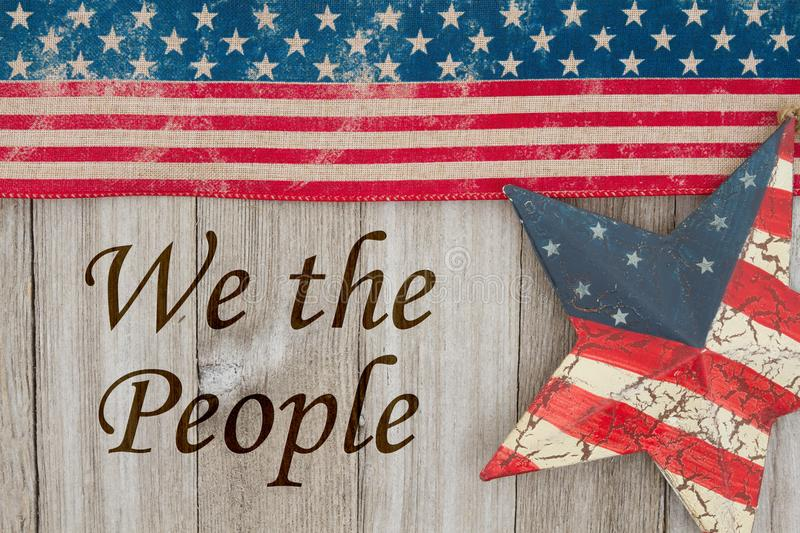America patriotic message We the People. America patriotic message, USA patriotic old flag and a star and weathered wood background with text We the People royalty free stock photos