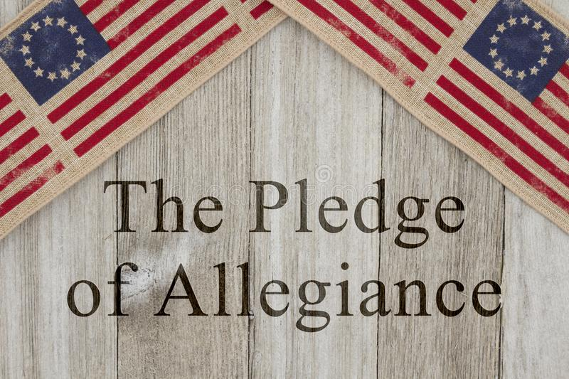 America patriotic message the pledge of allegiance. America patriotic message, USA patriotic old flag on a weathered wood background with text The Pledge of royalty free stock photography