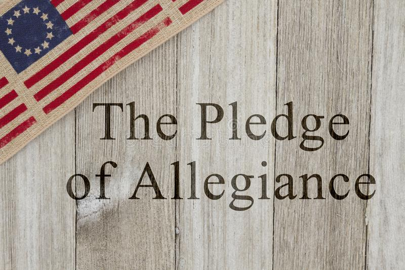 America patriotic message of the pledge of allegiance. America patriotic message, USA patriotic old flag on a weathered wood background with text The Pledge of stock photos