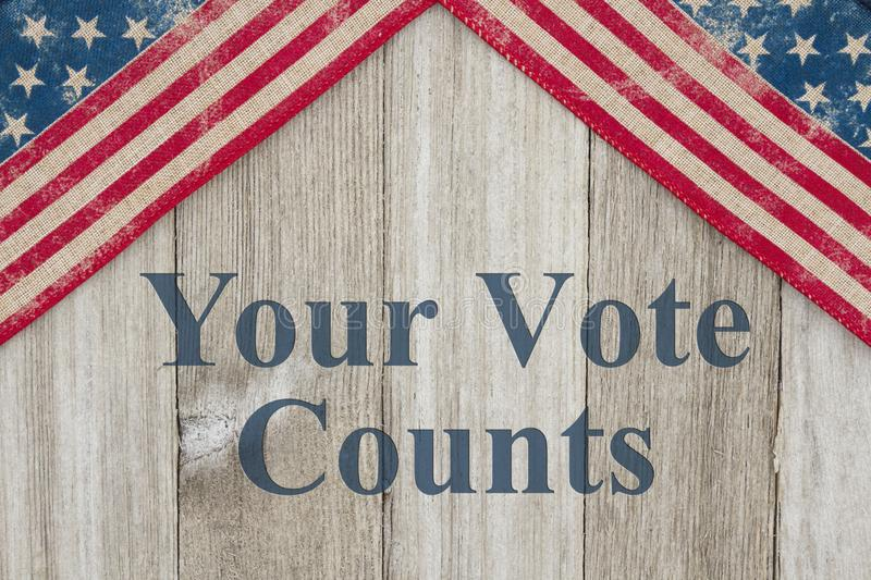 America patriotic message your vote counts. America patriotic message, USA patriotic old flag on a weathered wood background with text Your Vote Counts royalty free illustration