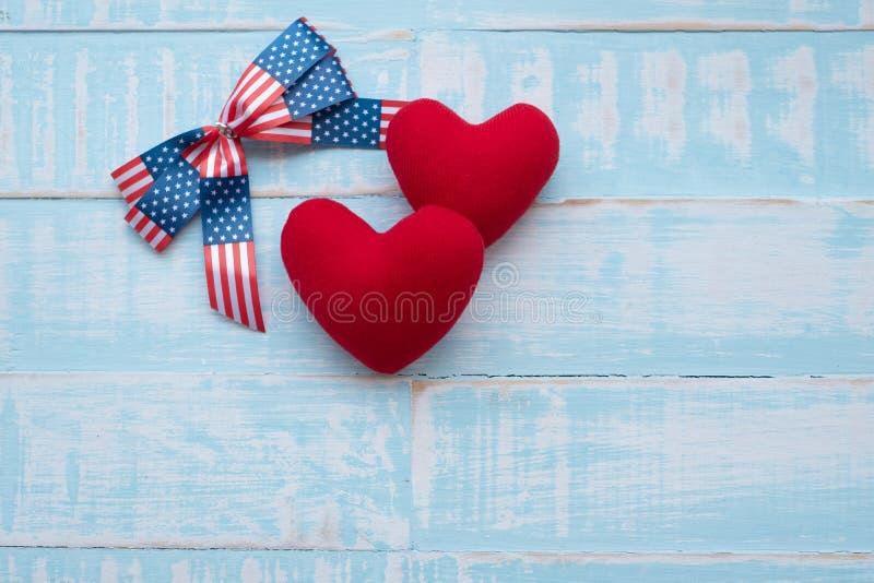 America ribbon on blue wood background royalty free stock photo